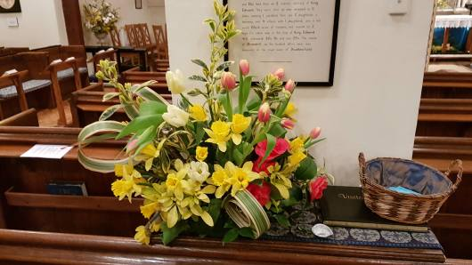 [Flowers arranged in church]